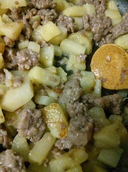 Brats, Greens, and Potatoes One Pot Dish Recipe - Browned Meat and Potatoes