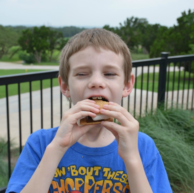 Eating Bacon Smores at Range Riders Club Kids Night Out Kid Activities at the JW Marriott San Antonio Hill Country Resort & Spa