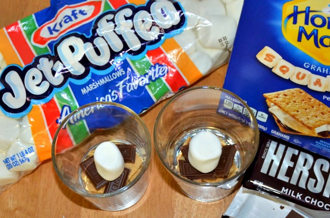 Place a single marshmallow on top of the chocolate pieces, one per bowl or cup  #LetsMakeSmores #CollectiveBias #Ad