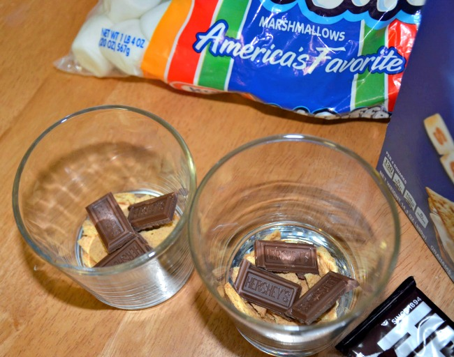 Top the graham cracker crumbs with 1/4 of a Hershey's Milk Chocolate bar each.  #LetsMakeSmores #CollectiveBias #Ad