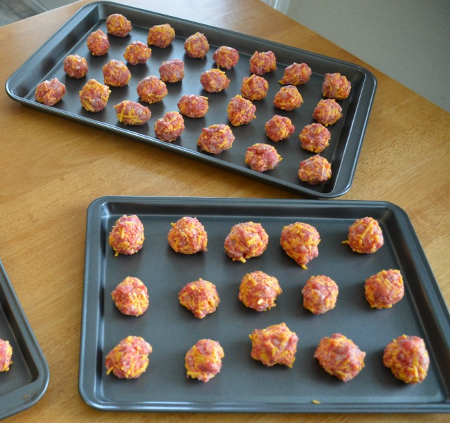 Easy Cheesy Sausage Balls - Roll into small balls - as seen on JennsRAQ.com #NaturallyCheesy #Ad