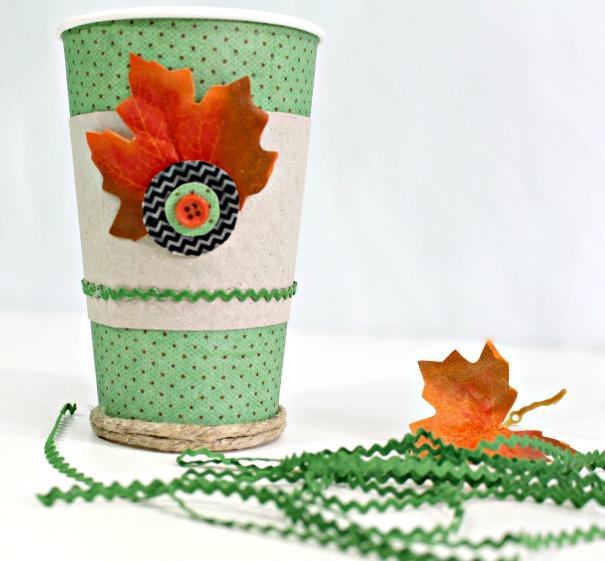 apply ric rac trim around the bottom edge of the fall coffee mug