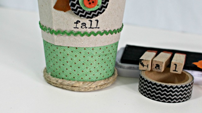 use ink and stamps to add the word FALL to your coffee cup