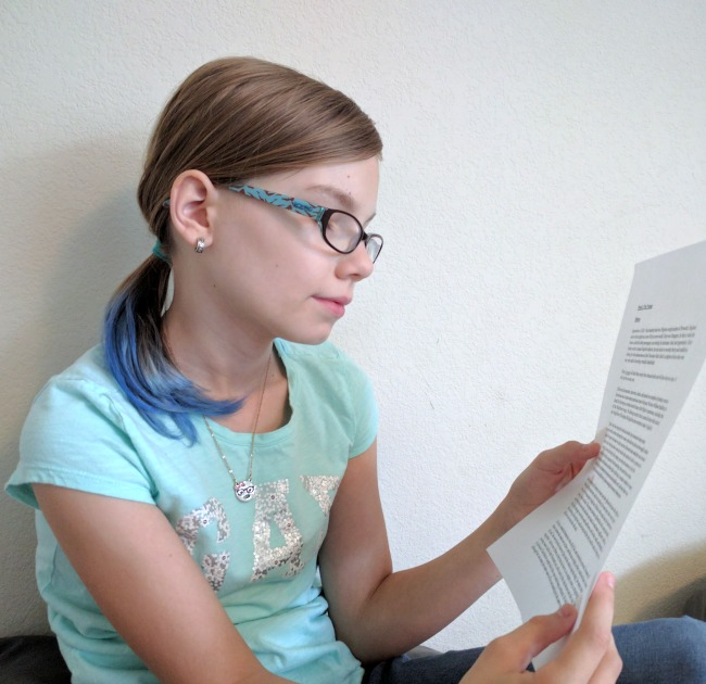 Grace reading the history of our Homeschool Legacy Thanksgiving Once-a-week micro-study