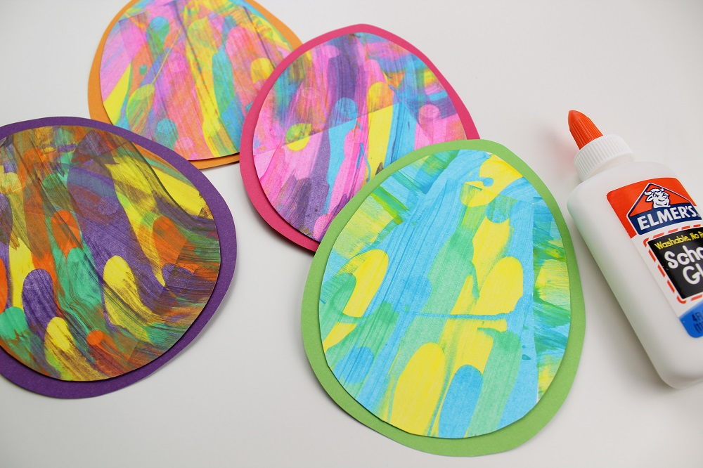 Paint Scrape Craft - Easter Eggs glued onto colorful paper