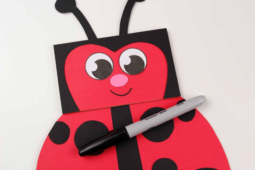 Paper Bag Craft - Ladybug Puppet Finishing Touches