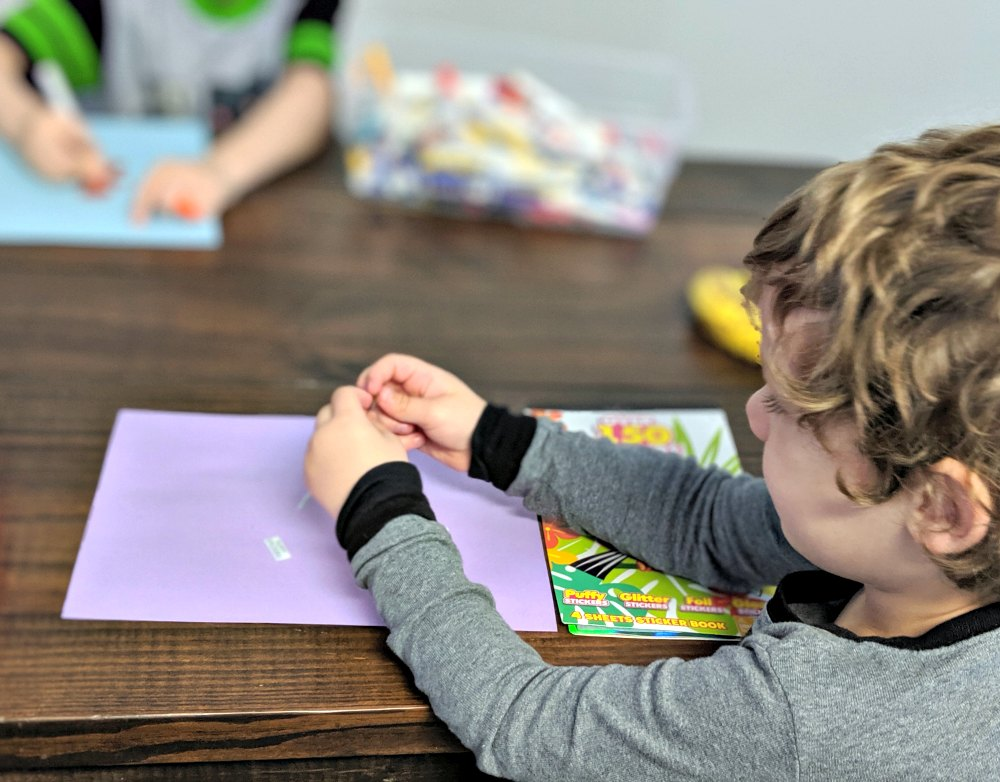 How to Juggle Homeschooling a Large Family - Entertain the littles