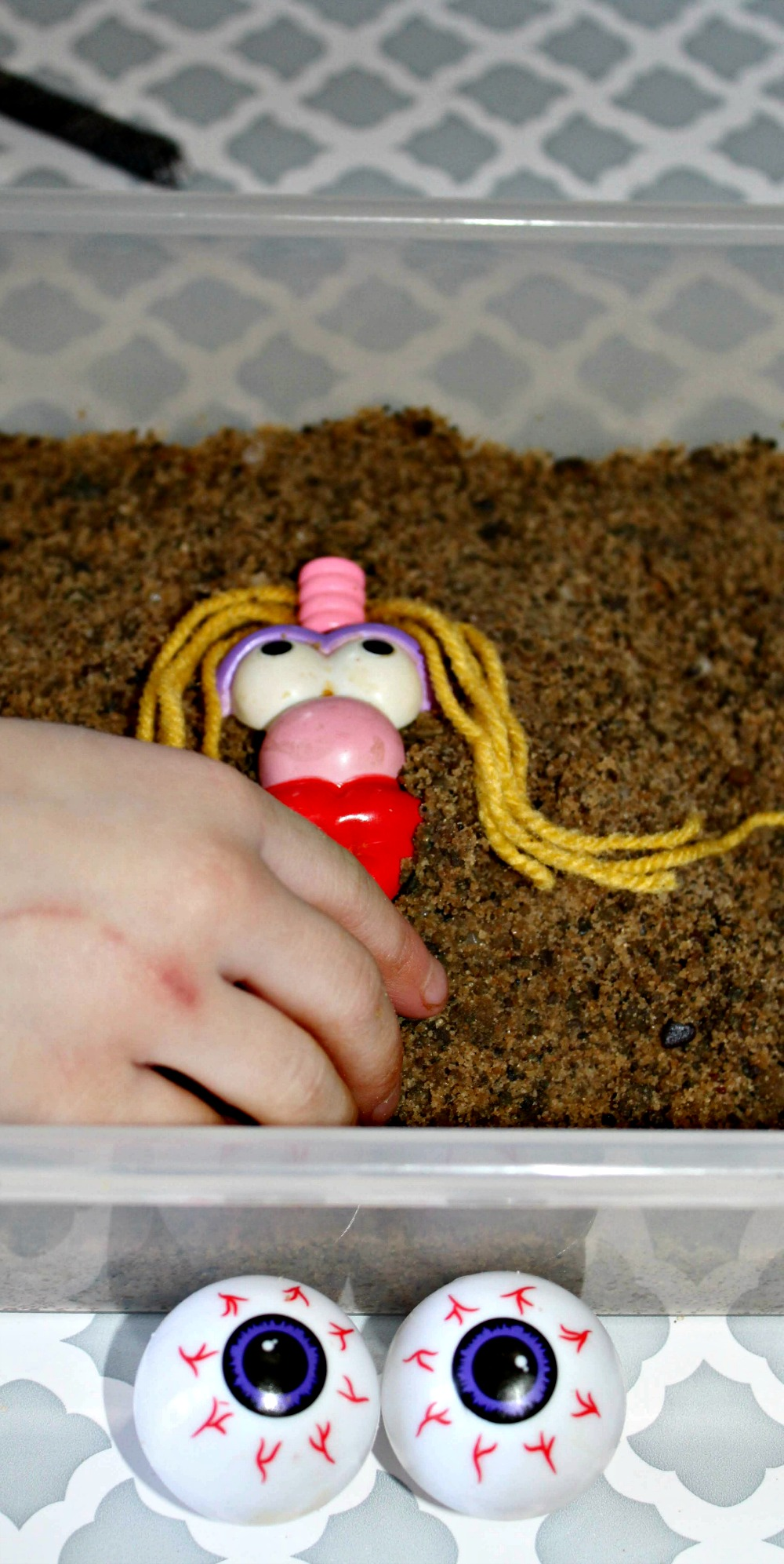 Silly Faces Sensory Bin DIY perfect for young children
